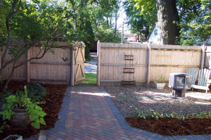 Milwaukee hardscaping, designer brick pathway, and backyard installments