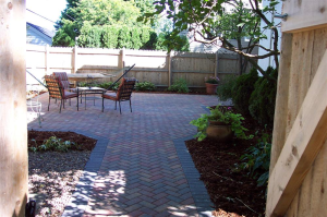 Multi-colored brick pathway and creative design transforms Milwaukee backyard