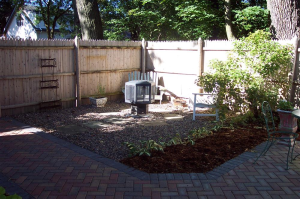 Backyard softscaping, multi-colored brick patio, and other designs from Milwaukee backyard building experts