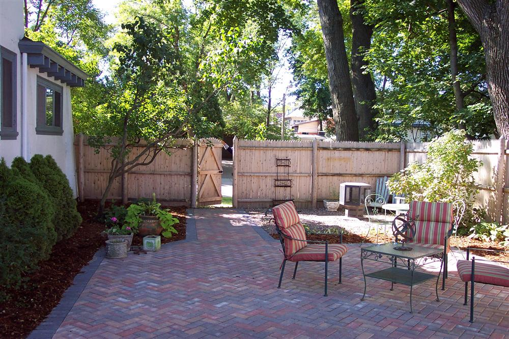 Brick patio with pathway, backyard brick installation, and landscape design from Milwaukee backyard improvement services