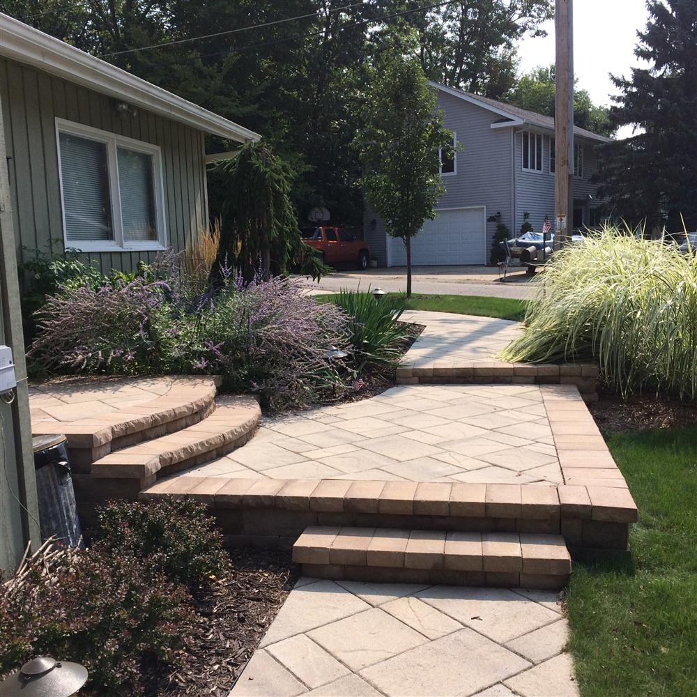 Decorative brick porches, entrance way stairs, and other creative installations from Burlington outdoor designers
