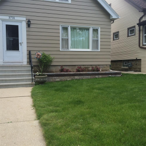 Brick retaining wall, landscaping, and other improvements from Cudahy outdoor specialists