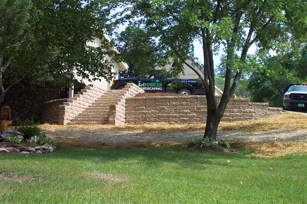 Big Bend brick retaining wall and lawn installation from Loomis Landscaping
