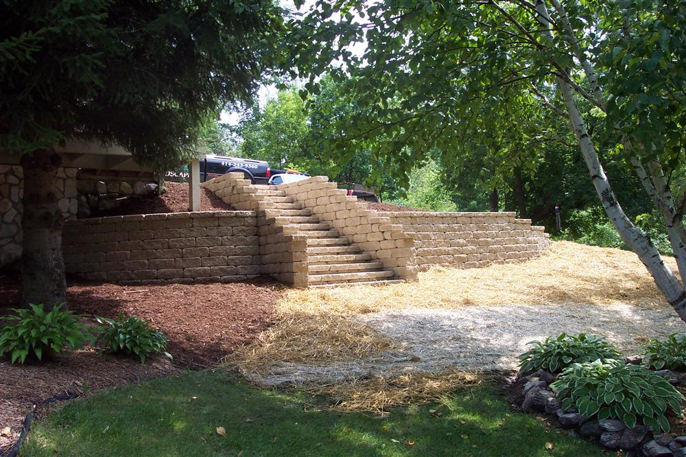 Brick stairs, retaining wall, and lawn installation services for Big Bend from Loomis Landscaping