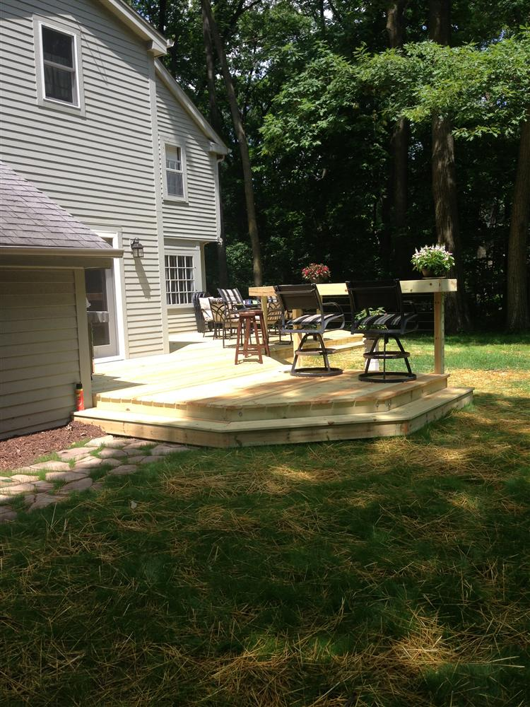 Wooden deck for Hartland backyard from Loomis Landscaping