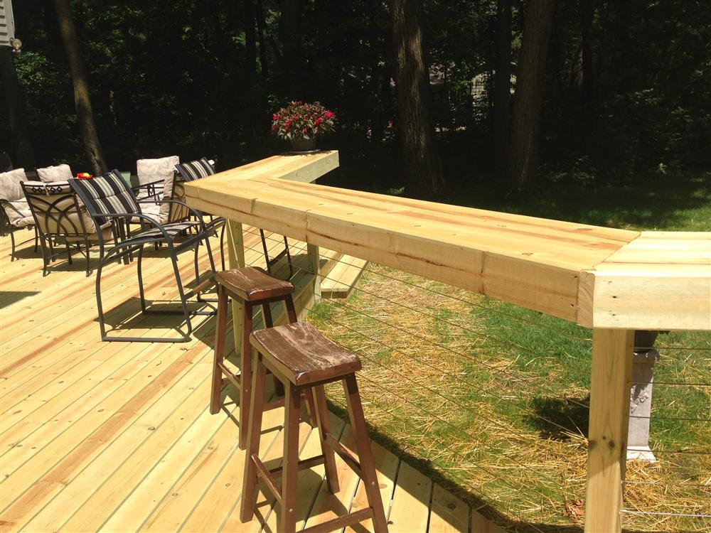 outdoor wooden deck with bar table