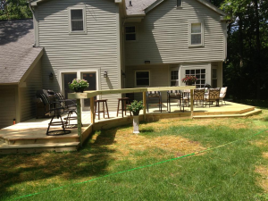 Wooden deck installation services from Loomis Landscaping in Hartland